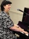 Liane singing and playing